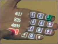 手就是滑鼠 鏡頭 遙控 電話還有....